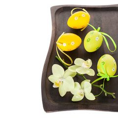 Easter composition with Easter eggs and flowers orchids