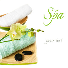 Spa concept: orchid flowers, zen stones and towel