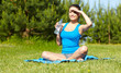 Outdoor workout woman. Fitness woman runner relaxing drinking wa