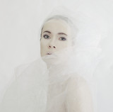 Tender girl in a white veil