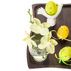 Easter eggs and flowers of orchids. Easter composition.
