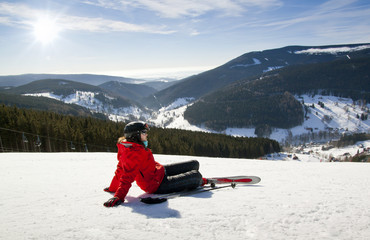 Female skier lying on snow, High mountain
