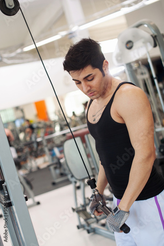 Young man training in the gym.