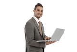 Young businessman using laptop smiling
