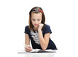 Little girl concentrates on the home task, isolated