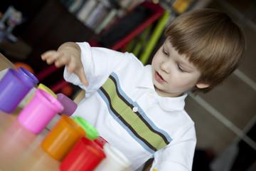 Little boy creating toys from playdough