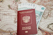 Passport and money lie on the background of the map of the world