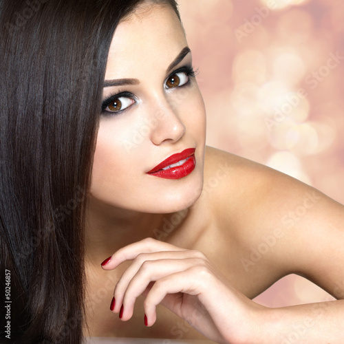Beautiful woman with long brown straight hairs.