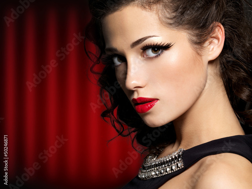 Beautiful face of brunette woman with red lips