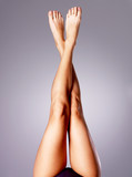 Beautiful long slender female legs after depilation
