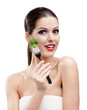 Woman with red lipstick eating broccoli on the stainless fork