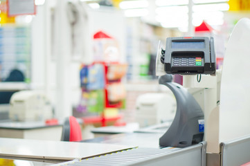 Empty cash desk with card payment terminal in supermarket