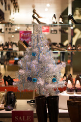 White christmas tree with balls in shoe store