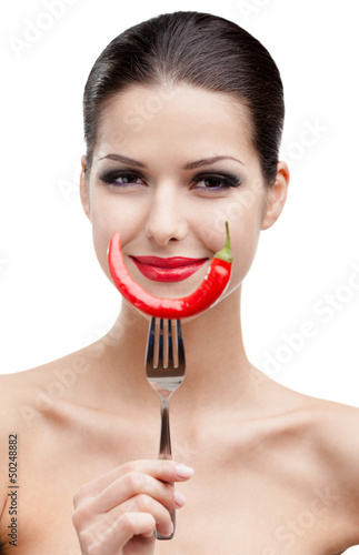 Woman with .chilli pepper on fork, isolated on white