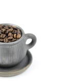 cup with coffee beans on a white