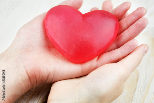 Heart in hands.