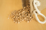 Pile of chickpeas beans  isolated on wood background