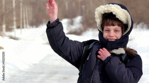 winter village boy goes to school-portrait