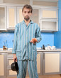drunk man standing in pajamas with onion