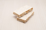 Pieces of Christmas hard almond turron on white background