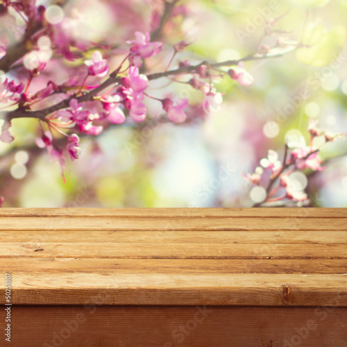 Spring blossom background with wooden deck table