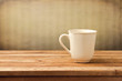 Vintage background with cup of tea on wooden table