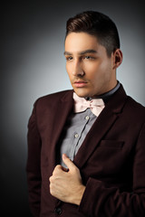 Sophisticated young man posing in a suit