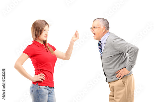 Angry father shouting at his daughter