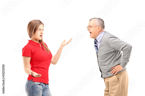 Angry mature man shouting at a young female