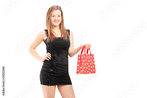 Beautiful young female holding a gift bag