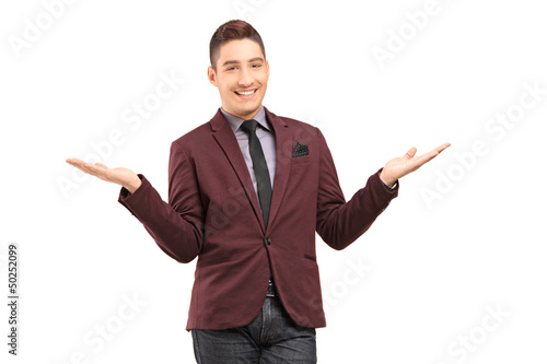 Stylish smiling male gesturing with hands