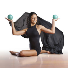 Woman exercising with balls