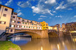 Florence, Italy. Wonderful sunset above Magnificent Ponte Vecchi