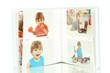 Open baby photo album isolated on white