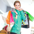 Shopping woman with color bags