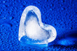 little heart of ice on a blue dewy background