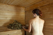 woman taking  steam  in sauna