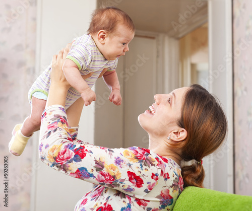 Happy mother holds to baby