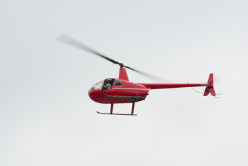 """Red Robinson R-44 """"Raven"""" helicopter"""