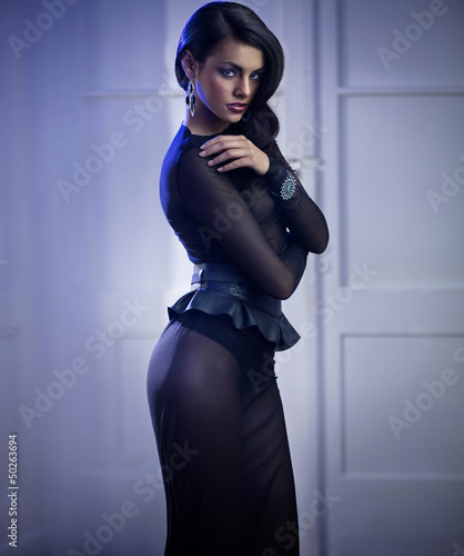 Mysterious elegant woman wearing evening dress
