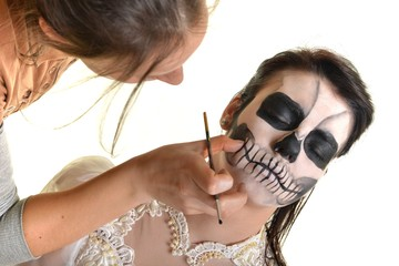 Creative face paint portrait .Day of the Dead persons