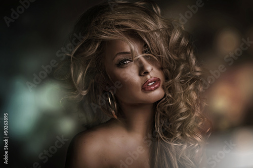 Perfect woman face with dark background