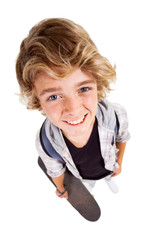 overhead view of cute teen boy on white background
