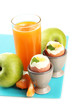 Light breakfast with boiled eggs and glass of juice, isolated