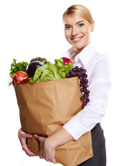 Young woman with a grocery shopping bag. Catering concept.