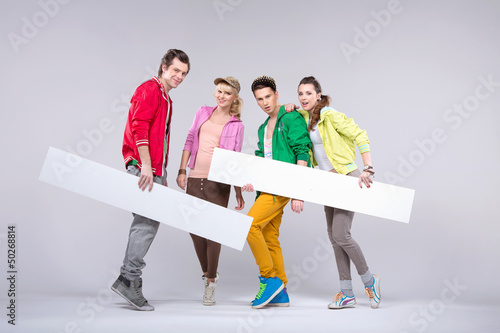 Group of teenagers in loose pose