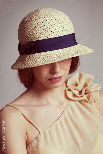 Cute girl in braided straw hat