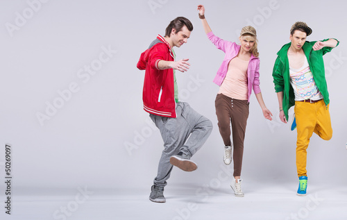 Cheerful young friends dancing together
