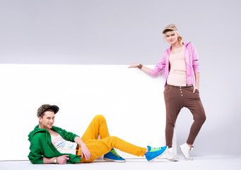 Cheerful teenagers in loose clothes