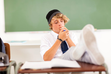 problematic teen boy smoking